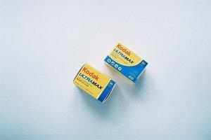 Two Kodak film rolls on a desk