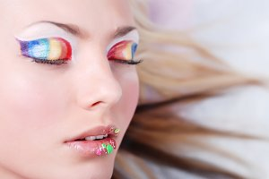 girl with make-up as a rainbow