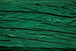 Old green paint on the wood