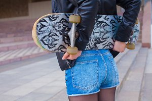 lady holding her skateboard