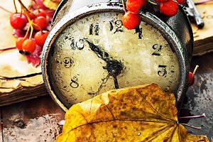 Alarm clock and fallen leaves