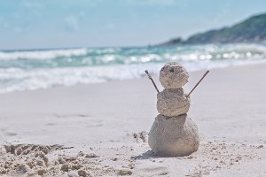 Snowman on the tropical beach