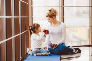 Mother and daughter playing with toys in the gym
