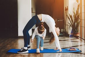 Two girls of different ages makeing yoga