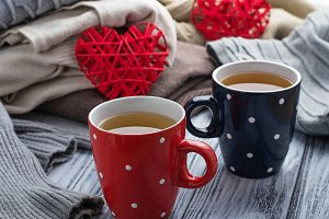 Warm knitted sweaters and cups