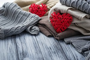 Warm knitted sweaters and hearts