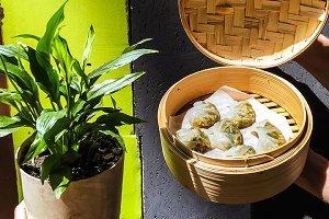 Dim sum in a in bamboo basket