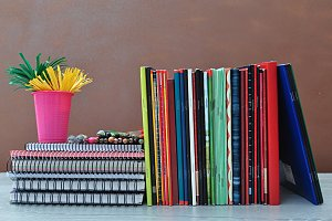 notebooks row and pencils