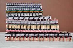 notebooks piled
