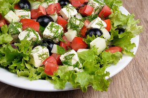 Vegetable salad with feta and olives