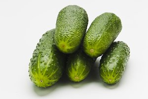 Green cucumbers on a white background