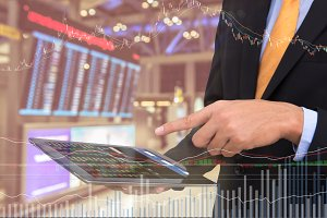 business man Trading using tablet