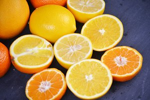 stack of citrus fruits slices. Oranges and lemons. On wooden table