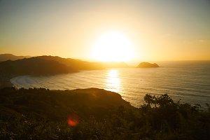 Sunset on a hill near sea