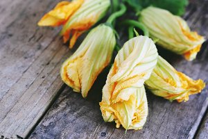 Zucchini flowers on a wooden table