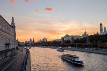 Sunset view of famous historical landmark of Russia - the Moscow river, Red Square and Kremlin at early autumn, Russia