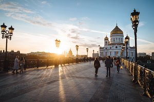 Famous christian landmark in Russia - Christ the Savior cathedral, sunset lights on gorgeous metal bridge, autumn in Moscow