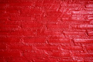 Painted brick wall, red color
