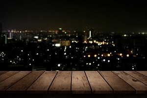 wood table top on night city