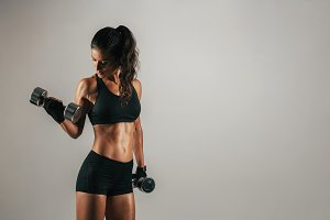 Athletic woman lifting