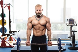 bodybuilder in the gym training with bar