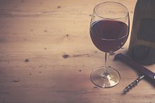 Red wine on a wooden background
