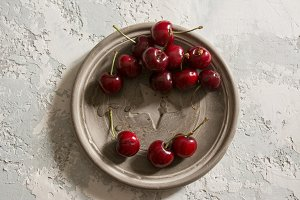 Cherries in concrete dish