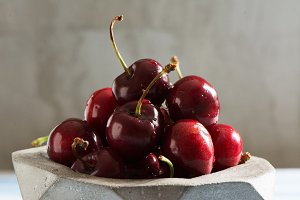 cherries in geometric concrete bowl