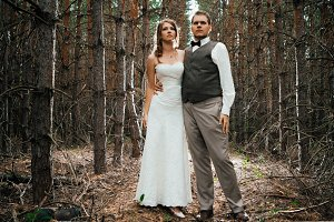 dramatic picture bride and groom on the background of leaves  forest