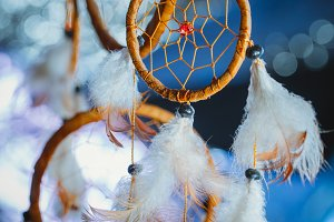 Dreamcatcher against a white blur of snow