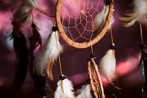 Dreamcatcher against a background of purple sunset dark