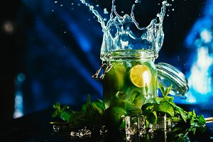 Bank mojito with lime and mint ice cube falling splash