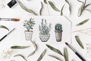 Workspace with watercolor plants