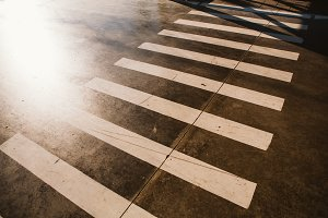 crosswalk zebra on background of asphalt in the summer