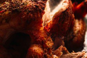 Fresh baked chicken with golden brown chopped closeup