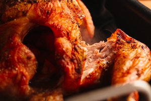 Baked chicken with fresh browned crust closeup