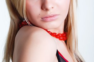 blonde with red roses on a neck