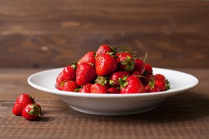 plate of ripe fresh strawberries