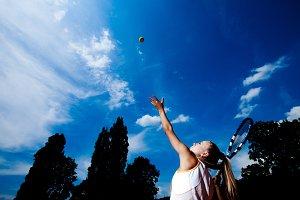 woman developing ball service