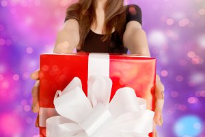 model holding big present box
