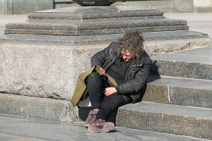 Homeless woman on stairs