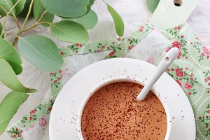 coffee sprinkled with cocoa powder