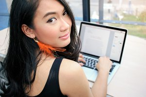 Asian businesswoman using laptop