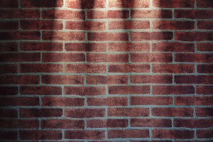 Brick wall illuminated.