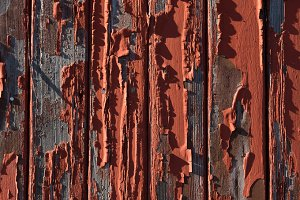 Weathered red wooden plank siding