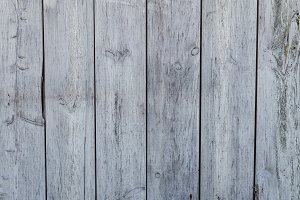 Weathered gray wooden plank siding