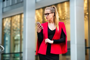 Beautiful businesswoman texting