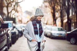 adult woman walking at city street