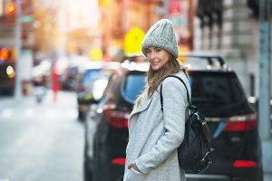 adult woman walking on city street