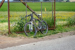 Old Bicycle against fence